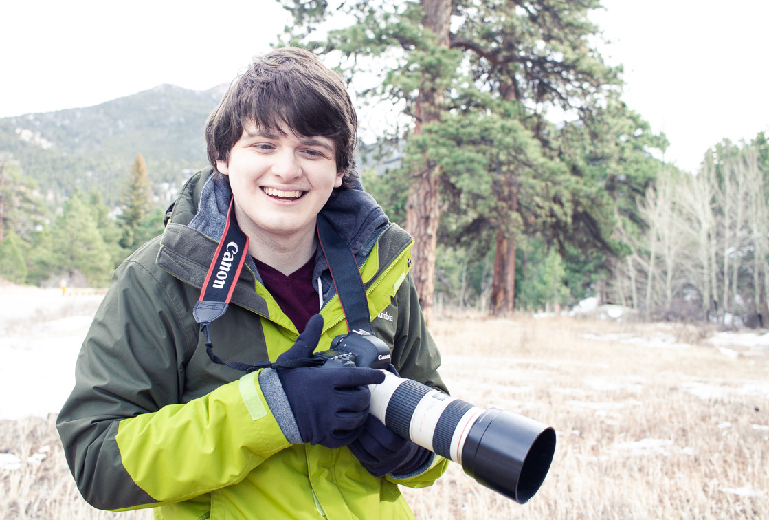 Jaymes Dempsey with camera doing photography in Colorado